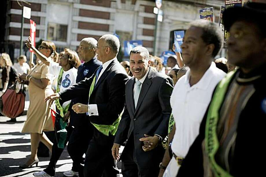 Governor David Paterson of New York was one of the Grand Marshals of the African American Day parade in Harlem on Sunday, September 20, 2009. Paterson defiantly vowed to run for election next year despite the White House's urging that he withdraw from the New York governor's race. Appearing tired and agitated as reporters crowded him at a parade in Harlem on Sunday, the governor said that he would not abandon his campaign to seek a full term. (Damon Winter/The New York Times) Photo: Damon Winter, NYT