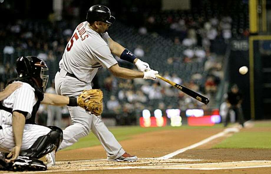 St. Louis Cardinals' Albert Pujols (5) hits a double as Houston Astros catcher Humberto Quintero, left, reaches for the pitch during the first inning of a baseball game Monday, Sept. 21, 2009 in Houston. (AP Photo/David J. Phillip) Photo: David J. Phillip, AP