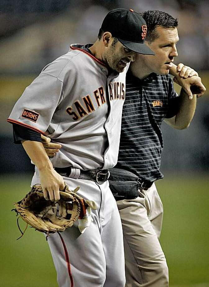 San Francisco Giants' Freddie Sanchez is helped off the field during the first inning of a baseball game against the  Arizona Diamondbacks, Monday, Sept. 21, 2009, in Phoenix. Photo: Matt York, AP