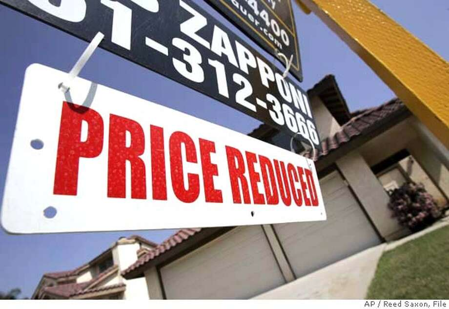 ###Live Caption:** FILE ** In this April 22, 2008 file photo, a sign outside a home offered for sale at a reduced in price is seen in Moreno Valley, Calif.. Housing prices dropped in February at the fastest rate ever, a widely watched index showed on Tuesday, reflecting that the housing slump is gaining momentum and showing no signs of letting up. (AP Photo/Reed Saxon, file)###Caption History:** FILE ** In this April 22, 2008 file photo, a sign outside a home offered for sale at a reduced in price is seen in Moreno Valley, Calif.. Housing prices dropped in February at the fastest rate ever, a widely watched index showed on Tuesday, reflecting that the housing slump is gaining momentum and showing no signs of letting up. (AP Photo/Reed Saxon, file)###Notes:###Special Instructions:APRIL 22, 2008 FILE PHOTO Photo: Reed Saxon