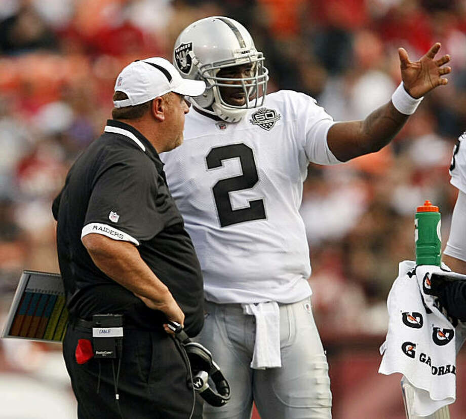 FILE - In this Aug. 22, 2009, file photo, Oakland Raiders coach Tom Cable taleks with quarterback JaMarcus Russell (2) during an NFL preseason football game against the San Francisco 49ers in San Francisco, Calif. Entering his third year in the NFL, Russell is now being counted on to show off that big arm that made him the top pick two years ago and help carry the Raiders back to being a winning team after a disastrous six-year run of losing. (AP Photo/Marcio Sanchez) Photo: Marcio Sanchez, AP