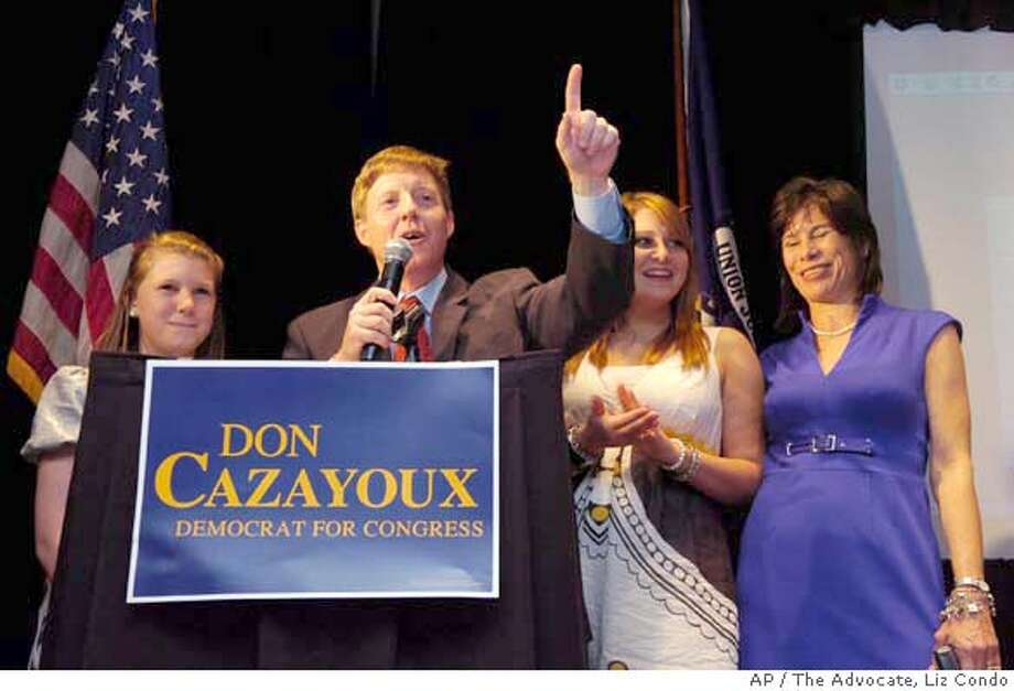 Democrat Don Cazayoux, center, celebrates his victory in the 6th Congressional District election over Republican opponent Woody Jenkins Saturday May 3, 2008 in Baton Rouge, La. Joining Cazayoux during his victory party in the Baton Rouge Womens Club are his daughters, Katie, left, and Chavanne, along with his wife, Cherie, at right. (AP Photo/The Advocate, Liz Condo) Photo: Liz Condo