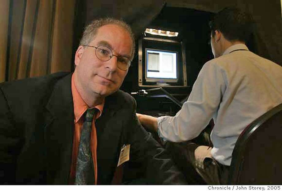 ###Live Caption:Brewster Kahle who is a digital archivist next to his machine that digitizes books at the Golden Gate Club in the Presidio. John Storey San Francisco Event on 10/25/05###Caption History:Kahle01_jrs_0129.jpg  Brewster Kahle who is a digital archivist next to his machine that digitizes books at the Golden Gate Club in the Presidio. John Storey San Francisco Event on 10/25/05 Ran on: 11-22-2005  Brewster Kahle introduces a scanner to digitize books and plans for a digital library at an event at the Presidio's Golden Gate Club. Ran on: 11-22-2005  Brewster Kahle introduces a scanner to digitize books and plans for a digital library at an event at the Presidio's Golden Gate Club.###Notes:###Special Instructions:MANDATORY CREDIT FOR PHOTOG AND SF CHRONICLE/NO SALES-MAGS OUT Photo: John Storey
