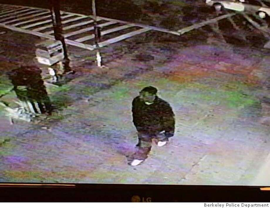 This photo taken from a South Berkeley liquor store shows a suspect being sought in connection with the shooting of a 16-year-old boy on May 2, 2008. Berkeley Police Department