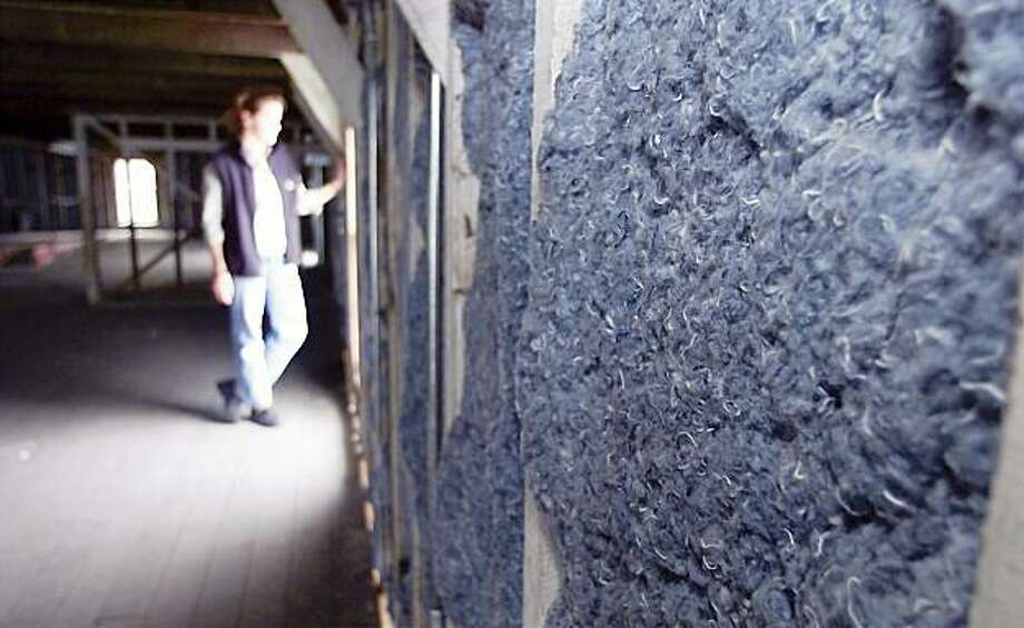 Shredded denim can be used as insulation. Photo: Brant Ward, The Chronicle