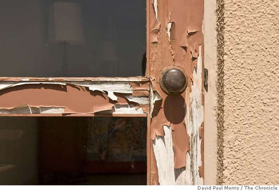###Live Caption:Paint chipping off the door leading out to the balcony is seen during a tour of the University of California's 13,239-square-foot presidential mansion known as Blake House May 7, 2008 in Kensington, Calif. (Photo by David Paul Morris / The Chronicle###Caption History:Paint chipping off the door leading out to the balcony is seen during a tour of the University of California's 13,239-square-fott presidential mansion known as Blake House May 7, 2008 in Kensington, Calif. (Photo by David Paul Morris / The Chronicle###Notes:###Special Instructions:MANDATORY CREDIT FOR PHOTOGRAPHER AND SAN FRANCISCO CHRONICLE/NO SALES-MAGS OUT Photo: David Paul Morris