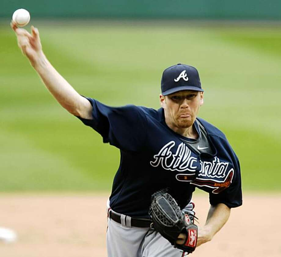 Atlanta Braves pitcher Tommy Hanson throws against the Washington Nationals during the first inning of a baseball game, Saturday, Sept. 26, 2009, in Washington. (AP Photo/Luis M. Alvarez) Photo: Luis Alvarez, AP