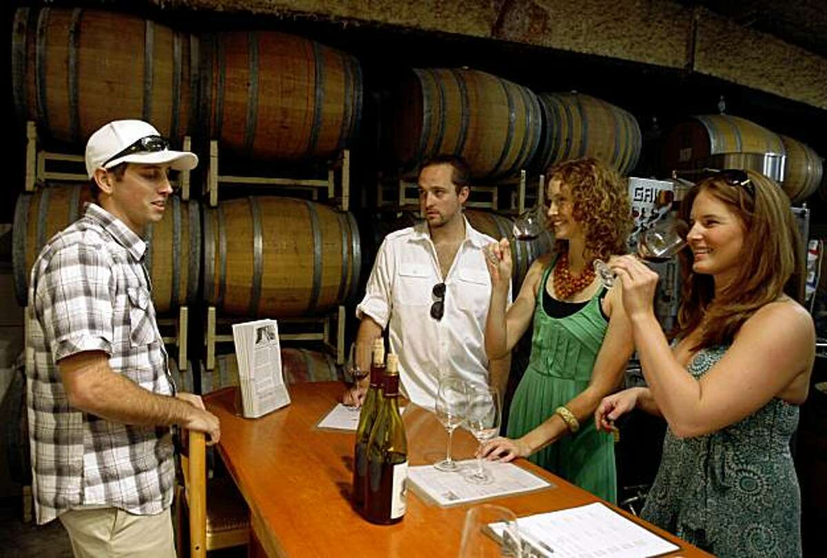 Cody Sapieka (left) pours wine for guests Steven Krystofiak, Layla Kajer and Kelly Keefe at the Joseph Swan Vineyards tasting room in Forestville, Calif., on Saturday, July 18, 2009.