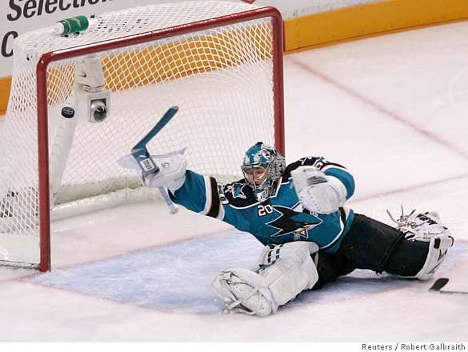 San Jose Sharks goalie Evgeni Nabokov is unable to stop a shot from Dallas Stars Mike Modano who scores in the third period during Game 2 of their NHL Western Conference semi-final hockey game in San Jose, California April 27, 2008. REUTERS/Robert Galbraith (UNITED STATES)  Ran on: 04-28-2008  Sharks goalie Evgeni Nabokov can't get to Mike Modano's shot, which broke a 2-2 tie early in the final period.  Ran on: 04-28-2008 Photo: ROBERT GALBRAITH