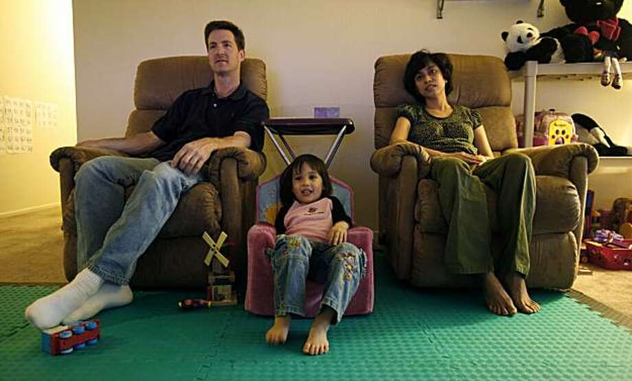 Gregg and Linda Maloof and their daughter Julia, 4, spend the evening at their Fremont, Calif., home on Saturday, April 19, 2008.  Gregg says that rising gas and food prices are forcing the family to eat at home and watch television more often rather than go out on the town.  Photo by Kim Komenich / San Francisco Chronicle Photo: Kim Komenich, SFC