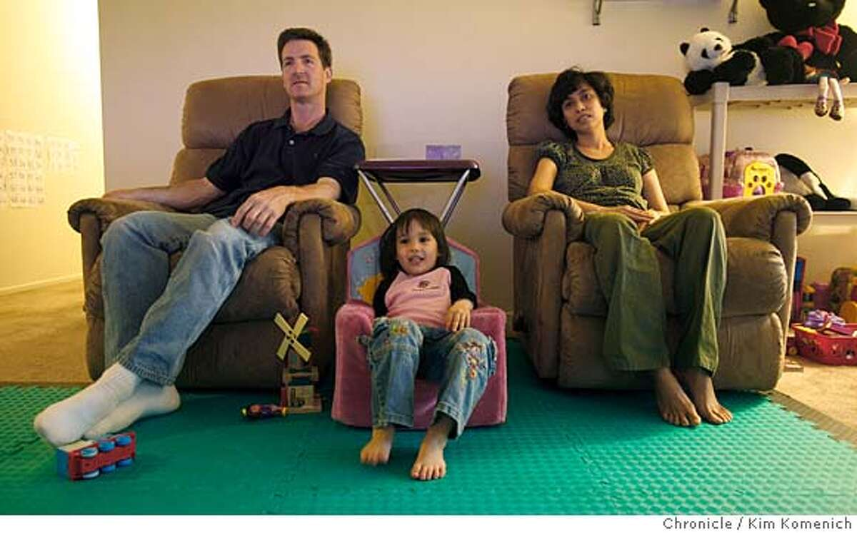 Gregg and Linda Maloof and their daughter Julia, 4, spend the evening at their Fremont, Calif., home on Saturday, April 19, 2008. Gregg says that rising gas and food prices are forcing the family to eat at home and watch television more often rather than go out on the town. Photo by Kim Komenich / San Francisco Chronicle Ran on: 04-27-2008 Gregg and Linda Maloof, with their daughter, Julia, 4, are staying home a lot more in their Fremont apartment, thanks to a tough economy and uncertain future.