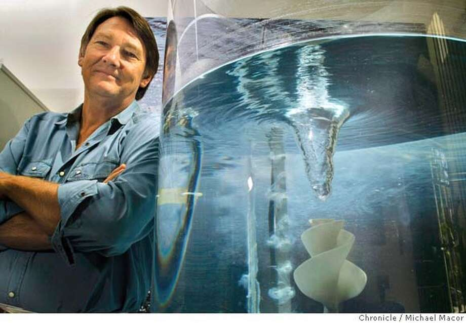 """Jay Harman, CEO of PAX Scientific in San Rafael, Calif. seen through the waters of a demonstration tank, on March 5, 2008, with an impeller he designed, called """"Lily"""" that creates a whirlpool that he uses in industrial designs to create things that consume less energy. Photo by Michael Macor/ San Francisco Chronicle Ran on: 03-23-2008  A crested gecko, one of nature's finer forms when it comes to locomotion, in Robert Full's Poly-PEDAL lab at UC Berkeley. Photo: Michael Macor"""