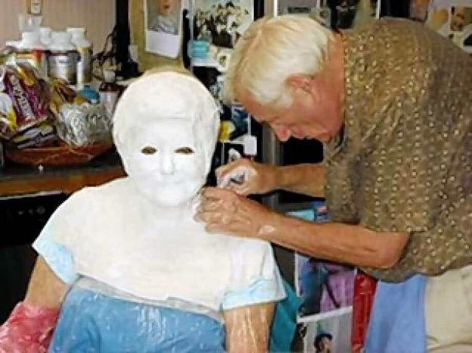 Holocaust survivor and San Francisco resident Gloria Lyon has her life mask done by artist Robert Sutz. Photo: Courtesy Of Robert Sutz