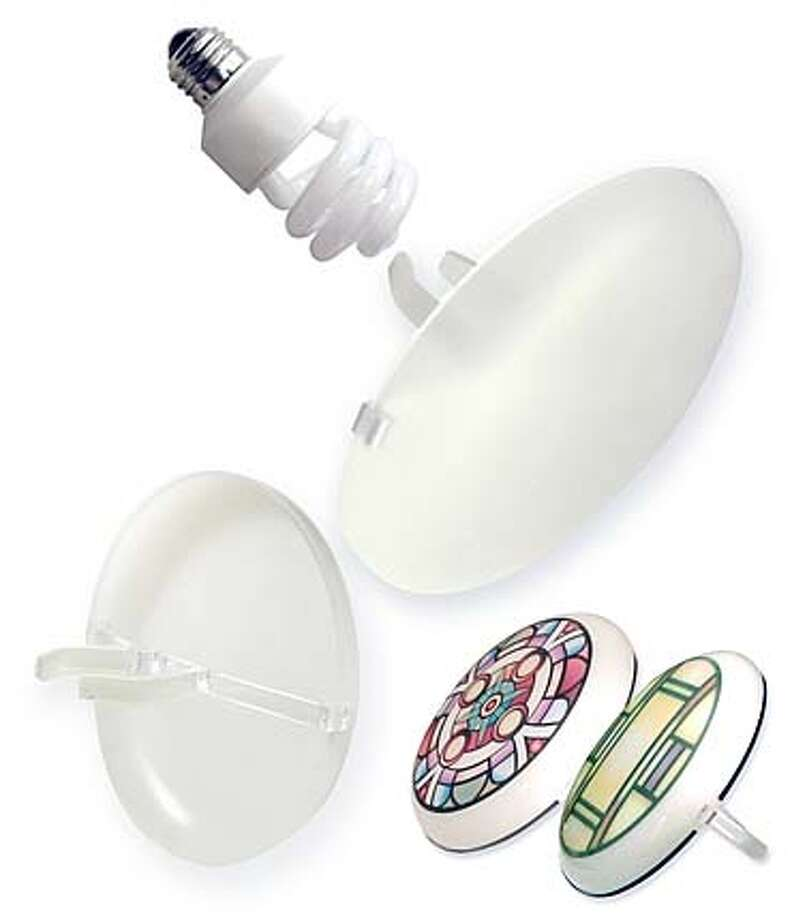 ###Live Caption:Lunet Lighting Cover that creates an attractive cover up for those unsightly spiral compact fluorescent bulbs. Created to reduce glare, reflect a more natural light, and add a decorative touch to overhead lighting, the Lunet Lighting Cover is a clip-on design that easily inserts right into the spiral bulb.###Caption History:Lunet Lighting Cover that creates an attractive cover up for those unsightly spiral compact fluorescent bulbs. Created to reduce glare, reflect a more natural light, and add a decorative touch to overhead lighting, the Lunet Lighting Cover is a clip-on design that easily inserts right into the spiral bulb.###Notes:###Special Instructions: Photo: Courtesy Of Firefly Energy Group