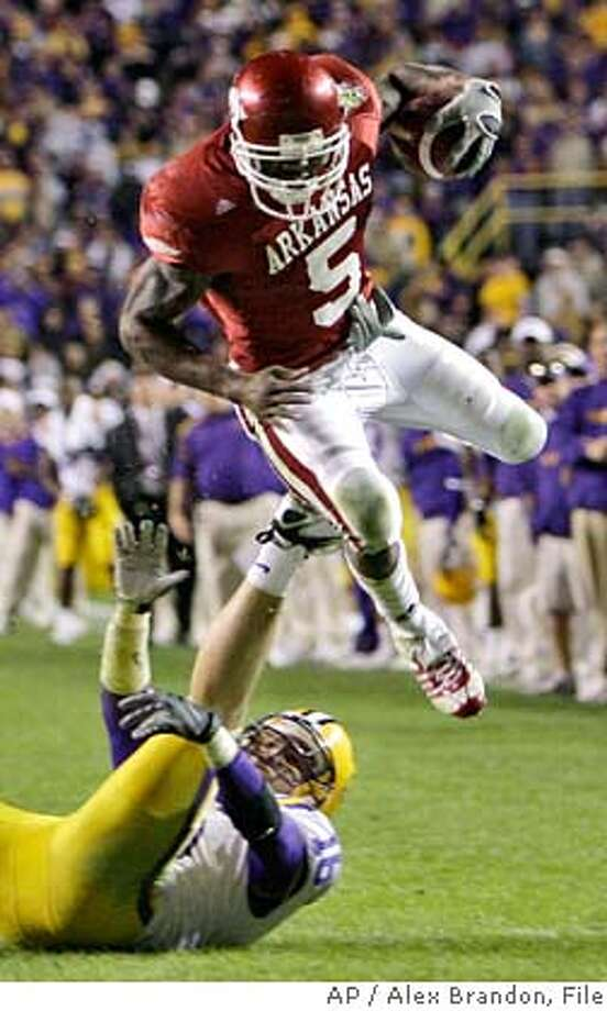 ###Live Caption:** FILE ** In this Nov. 23, 2007 file photo, Arkansas running back Darren McFadden (5) jumps over LSU safety Craig Steltz during the third overtime period of their college football game in Baton Rouge, La. McFadden is a top prospect in the upcoming 2008 NFL football draft on Saturday, April 26, 2008. (AP Photo/Alex Brandon, File)###Caption History:** FILE ** In this Nov. 23, 2007 file photo, Arkansas running back Darren McFadden (5) jumps over LSU safety Craig Steltz during the third overtime period of their college football game in Baton Rouge, La. McFadden is a top prospect in the upcoming 2008 NFL football draft on Saturday, April 26, 2008. (AP Photo/Alex Brandon, File)###Notes:Darren McFadden, Craig Steltz###Special Instructions:A NOV. 23, 2007 FILE PHOTO EFE OUT Photo: Alex Brandon