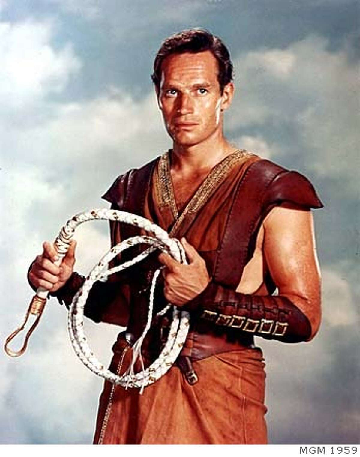 """###Live Caption:(NYT7) UNDATED -- April 6, 2008 -- OBIT-HESTON-7 -- Charton Heston in the title role in """"Ben-Hur."""" Heston, who appeared in some 100 films in his 60-year acting career but who is remembered chiefly for his monumental, jut-jawed portrayals of Moses, Ben-Hur and Michelangelo, died Saturday night, April 5, 2008, at his home in Beverly Hills, Calif. He was 84, according to his family. (MGM via The New York Times) EDITORIAL USE ONLY - MAGS OUT/NO SALES - FOR USE ONLY WITH STORY SLUGGED: OBIT-HESTON BY ROBERT BERKVIST - ALL OTHER USE PROHIBITED###Caption History:(NYT7) UNDATED -- April 6, 2008 -- OBIT-HESTON-7 -- Charton Heston in the title role in """"Ben-Hur."""" Heston, who appeared in some 100 films in his 60-year acting career but who is remembered chiefly for his monumental, jut-jawed portrayals of Moses, Ben-Hur and Michelangelo, died Saturday night, April 5, 2008, at his home in Beverly Hills, Calif. He was 84, according to his family. (MGM via The New York Times) EDITORIAL USE ONLY - MAGS OUT/NO SALES - FOR USE ONLY WITH STORY SLUGGED: OBIT-HESTON BY ROBERT BERKVIST - ALL OTHER USE PROHIBITED Ran on: 04-08-2008 Charlton Heston, in Ben-Hur (1959), was incapable of playing a small man.###Notes:CHARLTON HESTON###Special Instructions:EDITORIAL USE ONLY - MAGS OUT/NO SALES - FOR USE ONLY WITH STORY SLUGGED: OBIT-HESTON BY ROBERT BERKVIST - ALL OTHER USE PROHIBITED"""