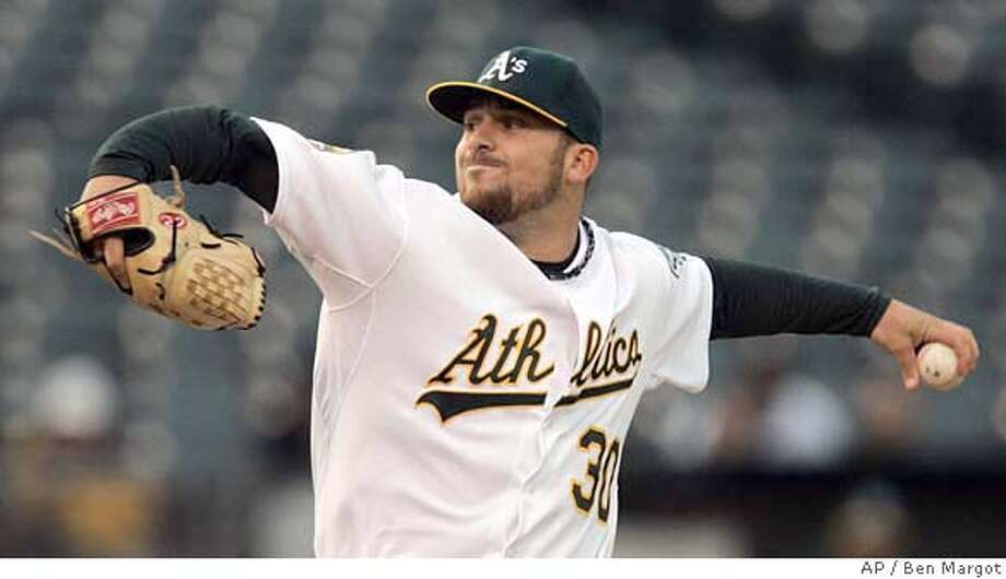 Oakland Athletics' Dana Eveland pitches to the Baltimore Orioles during the first inning of a baseball game Monday, May 5, 2008, in Oakland, Calif. (AP Photo/Ben Margot) Photo: Ben Margot