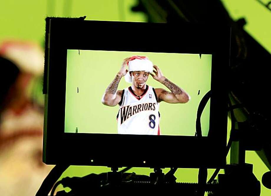 Warriors guard Monta Ellis adjusts his hat for an in-house holiday ad. The annual Golden State Warriors media day was held at the Warriors' practice facility at the Oakland Marriott on Monday. Photo: Brant Ward, The Chronicle