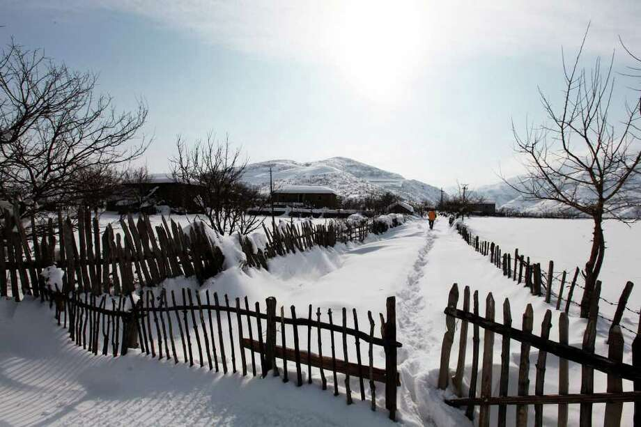 View of the Gjegjan village, 100 miles (160 km) northeast of capital Tirana, Thursday, Feb. 9, 2012, blocked by recent heavy snow and low temperatures. Many communes in the north and east of the country have been isolated due to heavy snow and icy roads. Photo: HEKTOR PUSTINA, Associated Press / AP