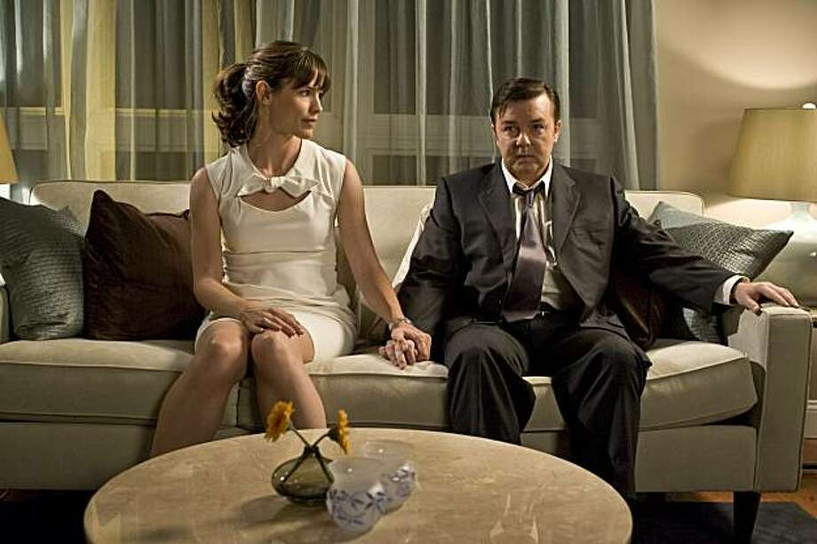 """Ricky Gervais and Jennifer Garner in """"The Invention of Lying."""" TSOTT-01427 JENNIFER GARNER as Anna McDoogles and RICKY GERVAIS as Mark Bellison in Warner Bros. PicturesÕ, Radar PicturesÕ and Media Rights CapitalÕs romantic comedy ÒThe Invention of Lying,Ó a Warner Bros. Pictures release. Photo: Sam Urdank, Warner Bros."""