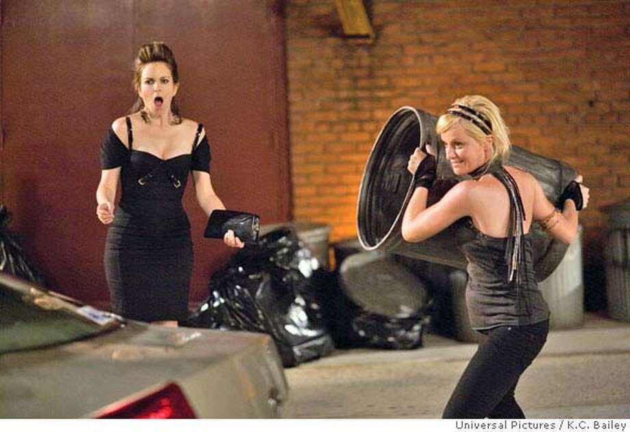 "(L to R) Mother-to-be Kate Holbrook (TINA FEY) and surrogate Angie (AMY POEHLER) trash an ex-boyfriend?s car in the comic story of two women, one apartment and the nine months that will change their lives--""Baby Mama."" Photo: K.C. Bailey"