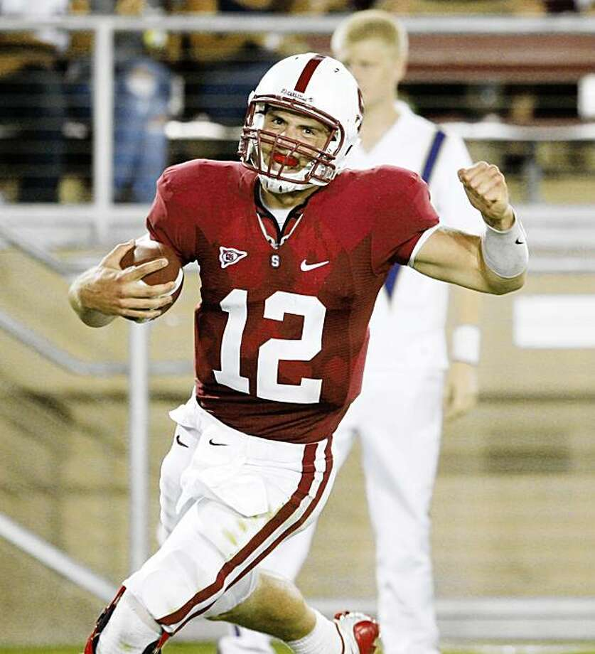 Stanford quarterback Andrew Luck (12) celebrates after he scored a touchdown against Washington in the fourth quarter in an NCAA football game in Stanford, Calif., Saturday, Sept. 26, 2009. (AP Photo/Paul Sakuma) Photo: Paul Sakuma, AP