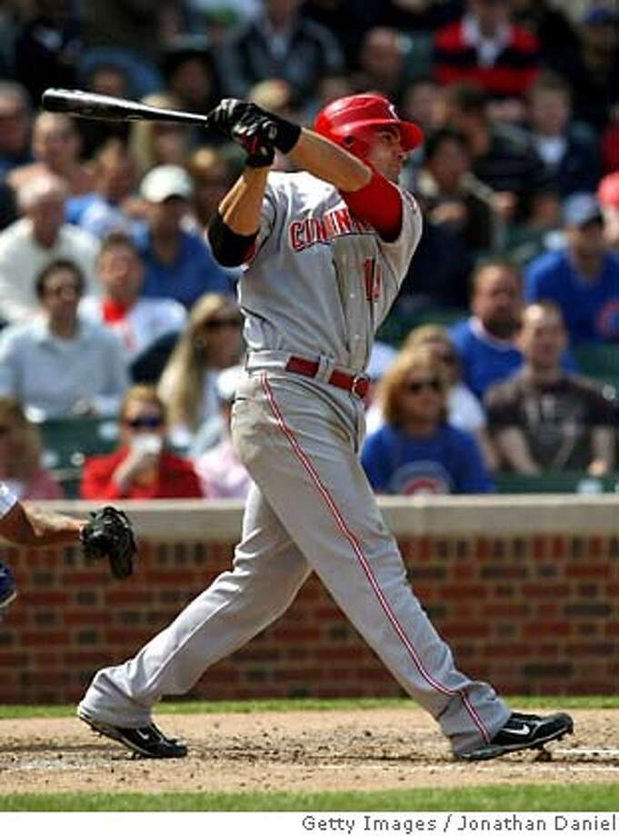 ###Live Caption:CHICAGO - APRIL 17: Joey Votto #19 of the Cincinnati Reds hits a three-run double in the fourth inning against the Chicago Cubs on April 17, 2008 at Wrigley Field in Chicago, Illinois. (Photo by Jonathan Daniel/Getty Images)###Caption History:CHICAGO - APRIL 17: Joey Votto #19 of the Cincinnati Reds hits a three-run double in the fourth inning against the Chicago Cubs on April 17, 2008 at Wrigley Field in Chicago, Illinois. (Photo by Jonathan Daniel/Getty Images)###Notes:Cincinnati Reds v Chicago Cubs###Special Instructions: Photo: Jonathan Daniel