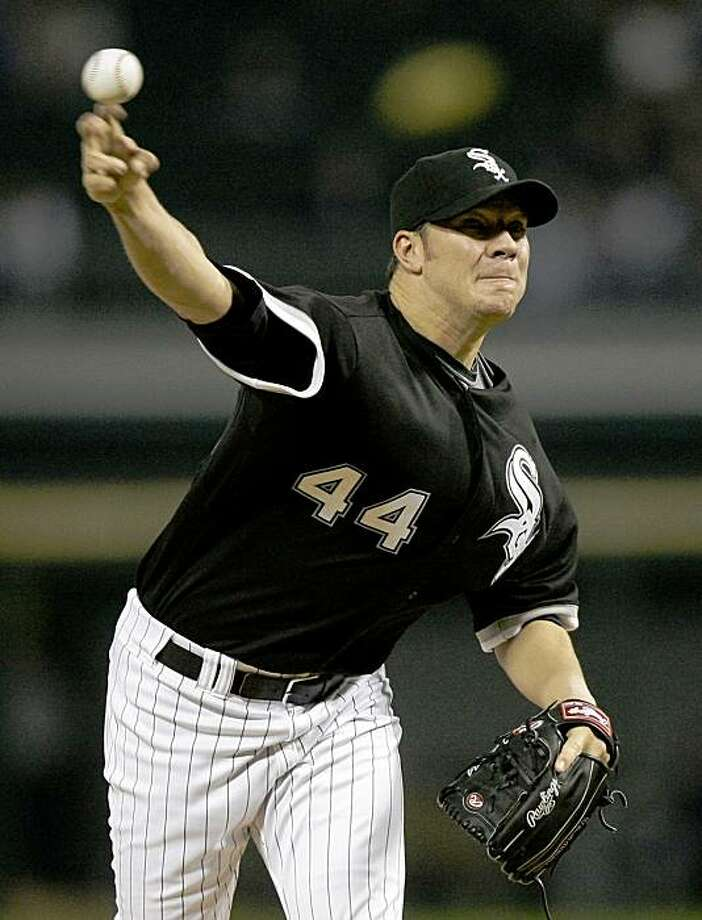 Chicago White Sox starting pitcher Jake Peavy delivers during the first inning of a baseball game  against the Detroit Tigers Friday, Sept. 25, 2009 in Chicago. (AP Photo/Charles Rex Arbogast) Photo: Charles Rex Arbogast, AP