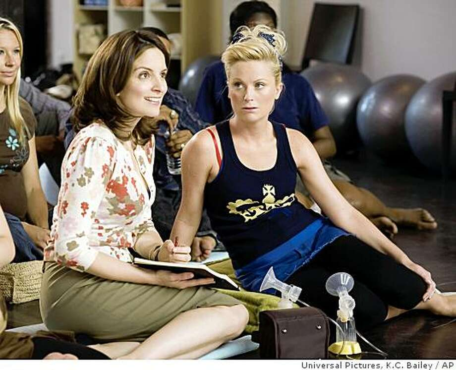 "n this image released by Universal Pictures, Tina Fey, left, who portrays single businesswoman Kate Holbrook, is shown in a scene with Amy Poehler, who portrays Angie Ostrowiski, in a scene from ""Baby Mama."" (AP Photo/Universal Pictures, K.C. Bailey)In this image released by Universal Pictures, Tina Fey, left, who portrays single businesswoman Kate Holbrook, is shown in a scene with Amy Poehler, who portrays Angie Ostrowiski, in a scene from ""Baby Mama.""  (AP Photo/Universal Pictures, K.C. Bailey) ** NO SALES ** Photo: Universal Pictures, K.C. Bailey, AP"