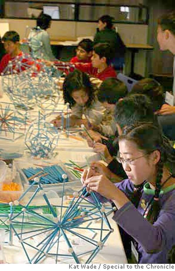 Jing Jing Li, 14, puts together a three-dimensional figure from which she can investigate its mathematical properties during the Julia Robinson Mathematics Festival held at Google headquarters on Sunday, May 4, 2008 on Sunday in Berkeley, Calif.  Kat Wade / Special to the Chronicl Photo: Kat Wade