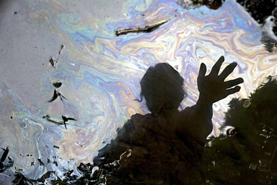 Cancer victim Maria Garofalo is reflected in the stream behind her home in the Ecuadorean Amazon. Photo: Juan Diego P?rez