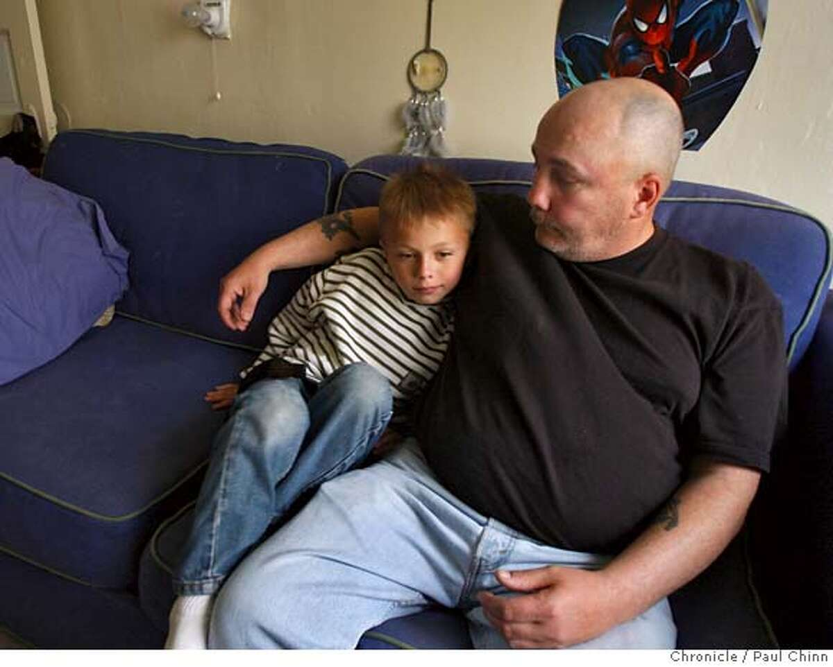 ###Live Caption:Seven-year-old Zachary Caltaldo rests at home with his father Anthony in Oakland, Calif., on Wednesday, April 23, 2008. Anthony Cataldo is considering legal action after his complaints about his son being bullied at his school, Piedmont Elementary, were not addressed by school officials. Zachary spent Monday night at Children's Hospital after he was hit by an older classmate. Photo by Paul Chinn / San Francisco Chronicle###Caption History:Seven-year-old Zachary Caltaldo rests at home with his father Anthony in Oakland, Calif., on Wednesday, April 23, 2008. Anthony Cataldo is considering legal action after his complaints about his son being bullied at his school, Piedmont Elementary, were not addressed by school officials. Zachary spent Monday night at Children's Hospital after he was hit by an older classmate. Photo by Paul Chinn / San Francisco Chronicle###Notes:Zachary Caltaldo, Anthony Cataldo###Special Instructions:MANDATORY CREDIT FOR PHOTOGRAPHER AND S.F. CHRONICLE/NO SALES - MAGS OUT