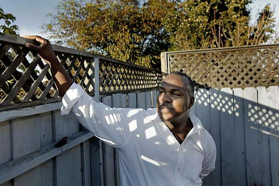 Joey Amacker stands in the back yard of his home. Photo: Carlos Avila Gonzalez, The Chronicle