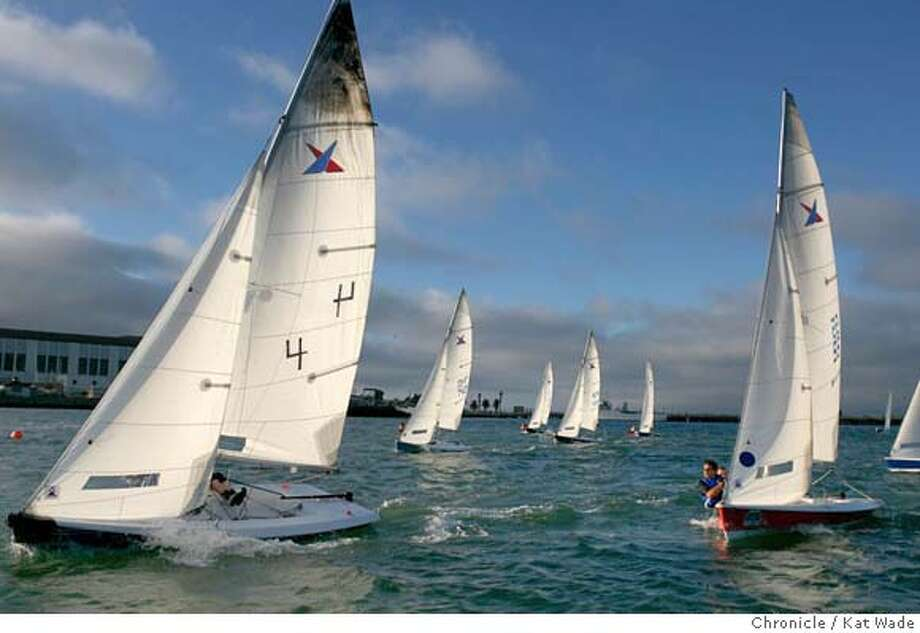 WADEsailboats_256_KW_.jpg With Berkeley/Emeryville in the background Vanguard15 , Fleet 53 whose homebase is the Treasure Island Sailing Center speed toward the finish line during a Thursday evening race sponsored by Treasure Isand Sailing Center, a non-profit organization that puts on races every Tuesday and Thursday nights during the summer. Tonight the 43 member Vanguard15, fleet 53 and the 17 member Lasers race in the 12-foot deep bay between Treasure Island and Yerba Buena Island on Thursday July 27, 2006. The sailers range from newbies and weekend sailors to Collegic All Americans and Olympians. Kat Wade/The Chronicle ** (Subjects) cq Photo: Kat Wade