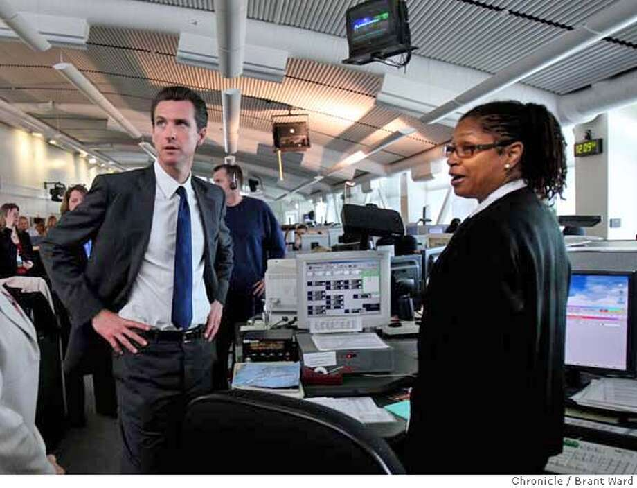 ###Live Caption:Mayor Gavin Newsom, left, and Battalion Chief Khai Ali, who works at the fire dispatch area in the 911 center, met as Newsom took a tour of the facility. San Francisco Mayor Gavin Newsom opened the newly remodeled Emergency Operations Center and visited with 911 dispatchers at their Turk Street headquarters Wednesday, April 16, 2008. Photo by Brant Ward / San Francisco Chronicle###Caption History:Mayor Gavin Newsom, left, and Battalion Chief Khai Ali, who works at the fire dispatch area in the 911 center, met as Newsom took a tour of the facility. San Francisco Mayor Gavin Newsom opened the newly remodeled Emergency Operations Center and visited with 911 dispatchers at their Turk Street headquarters Wednesday, April 16, 2008. Photo by Brant Ward / San Francisco Chronicle  Ran on: 04-17-2008  Battalion Chief Khai Ali talks with Mayor Gavin Newsom (left) at the city's 911 call center.###Notes:###Special Instructions: Photo: Brant Ward