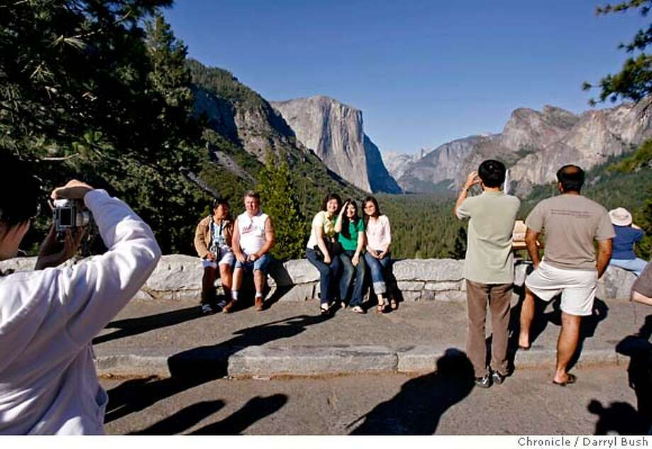 "###Live Caption:x###Caption History:elportal25_0466_db.jpg  Tourists pose for pictures at ""Tunnel View"" East of the Wawona tunnel, which shows a classic view of the Yosemite Valley, including El Capitan, Half Dome, Sentinel Rock, Cathedral Rocks and Bridalveil Fall in Yosemite National Park. The Ferguson Rock Slide has closed Highway 140 near the town of El Portal, leading to the Arch Rock Entrance of Yosemite National Park in Mariposa County, CA on Tuesday, June 20, 2006. shot: 6/20/06  Darryl Bush / The Chronicle ** (cq)###Notes:###Special Instructions:MANDATORY CREDIT FOR PHOTOG AND SF CHRONICLE/NO SALES-MAGS OUT Photo: Darryl Bush"