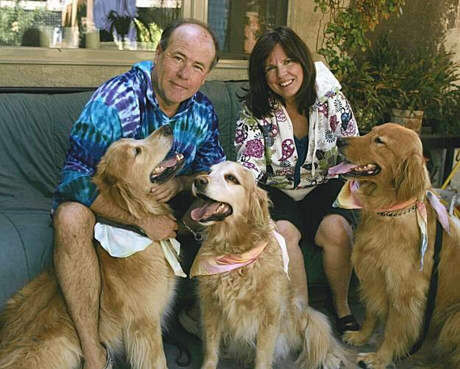 Bob Kemmerle, Carolyn Arnold and the pack Photo: Bob Heath