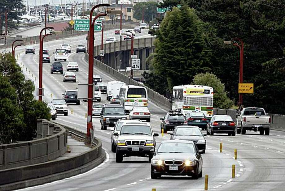 Commuters travel across Doyle Drive in the Presidio near the Golden Gate Bridge in San Francisco, Calif., on Friday, July 24, 2009. Caltrans revealed to the bridge's Board of Directors its ambitious plans to replace the viaduct. Photo: Paul Chinn, The Chronicle