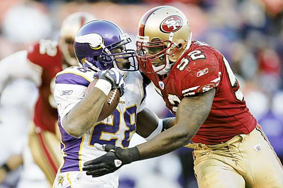 SAN FRANCISCO - DECEMBER 9:  Running back Adrian Peterson #28 of the Minnesota Vikings is hit by linerbacker Patrick Willis #52 of the San Francisco 49ers during a game on December 9, 2007 at Monster Park in San Francisco, California. Minnesota won 27-7.  (Photo by Greg Trott/Getty Images) Photo: Greg Trott, Getty Images