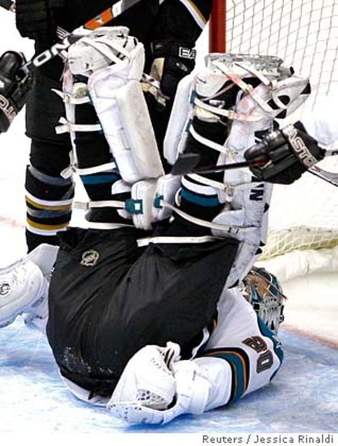 ###Live Caption:San Jose Sharks goalie Evgeni Nabokov covers up the puck to make a save on the Dallas Stars during Game 4 of their NHL Western Conference semi-final hockey game in Dallas, Texas, April 30, 2008. REUTERS/Jessica Rinaldi (UNITED STATES)###Caption History:San Jose Sharks goalie Evgeni Nabokov covers up the puck to make a save on the Dallas Stars during Game 4 of their NHL Western Conference semi-final hockey game in Dallas, Texas, April 30, 2008. REUTERS/Jessica Rinaldi (UNITED STATES)###Notes:San Jose Sharks goalie Nabokov covers up the puck to make a save on the Dallas Stars during Game 4 of their NHL Western Conference semi-final hockey game###Special Instructions:0 Photo: JESSICA RINALDI