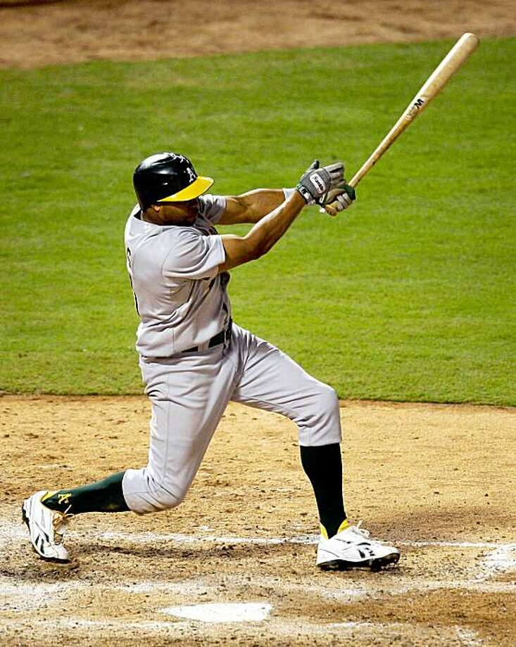 Oakland Athletics' Rajai Davis follows through on an infield single to second off a pitch from Texas Rangers' C.J. Wilson in the eighth inning of a baseball game in Arlington, Texas, Tuesday Sept. 15, 2009.  (AP Photo/Tony Gutierrez) Photo: Tony Gutierrez, AP