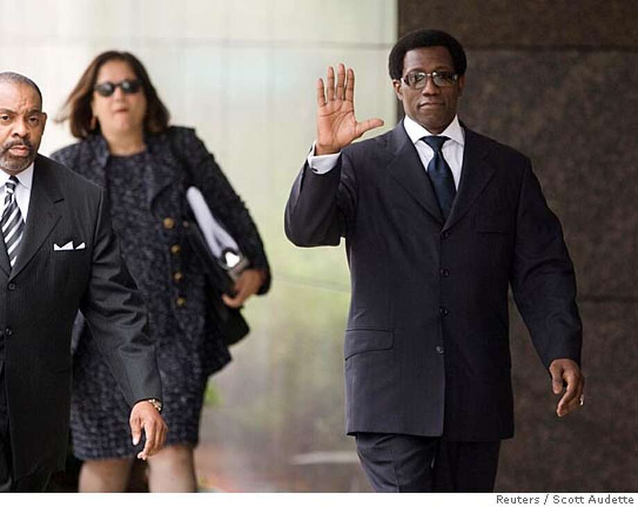 "Actor Wesley Snipes (R) waves while walking into the federal courthouse for sentencing in Ocala, Florida April 24, 2008. Snipes, who starred in the ""Blade"" movies series, was convicted in February on three misdemeanor counts of willfully failing to file federal tax returns for 1999-2001. REUTERS/Scott Audette (UNITED STATES) Photo: SCOTT AUDETTE"