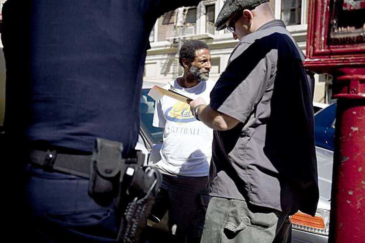 A drug bust suspect is being processed at the corner of Ellis and Jones Street in San Francisco, Calif. on Tuesday, Sept. 15, 2009. As part of new police chief George Gascon's Tenderloin sweeps, officers in the district are targeting drug deals within the radius of schools for a drug-free school zone per California Health And Safety Code 11353.6 where violators will then be persecuted with extra prison terms.