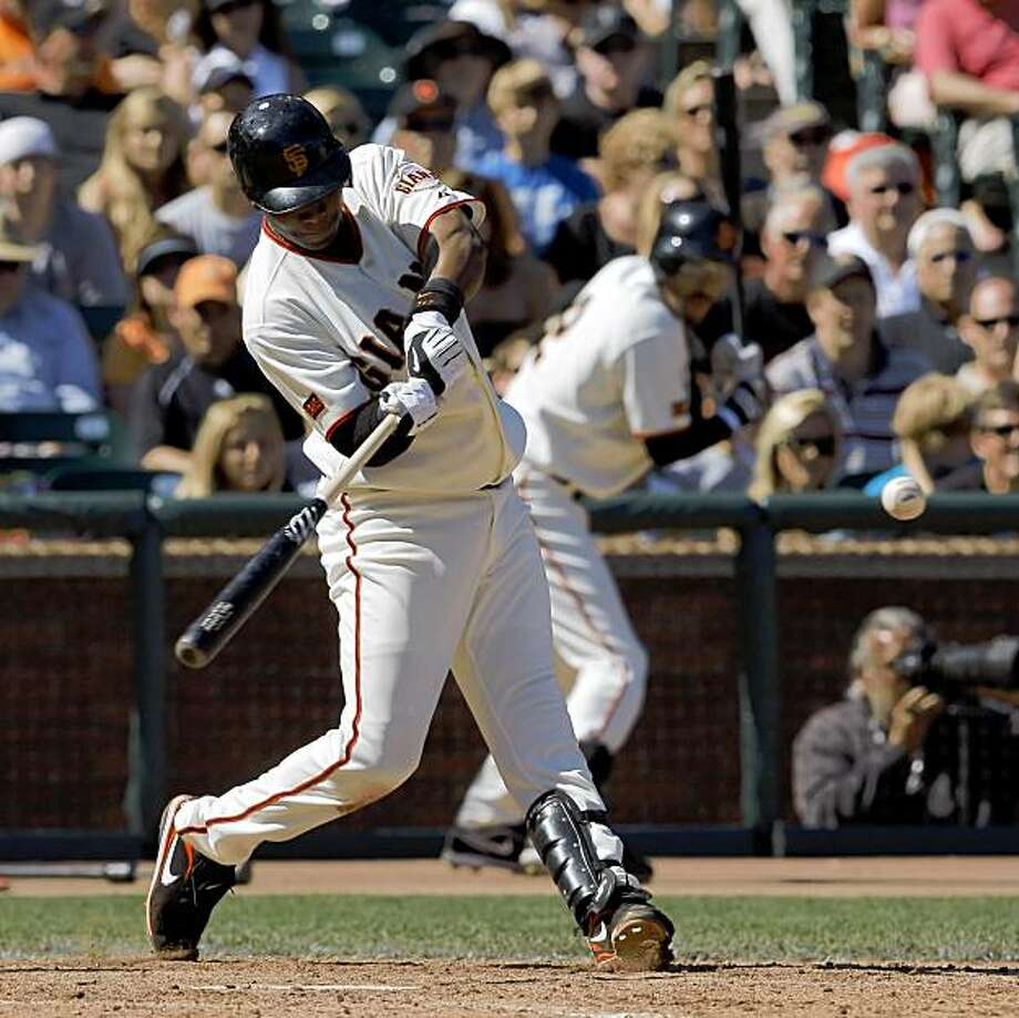 Edgar Renteria hits a grand slam in the bottom of the seventh inning gave the giants the lead. The San Francisco Giants played the Colorado Rockies at AT&T Park in San Francisco, Calif., on Sunday, August 30, 2009. The Giants won 9-5, sweeping the series and tied the Rockies for the wildcard. Photo: Carlos Avila Gonzalez, The Chronicle