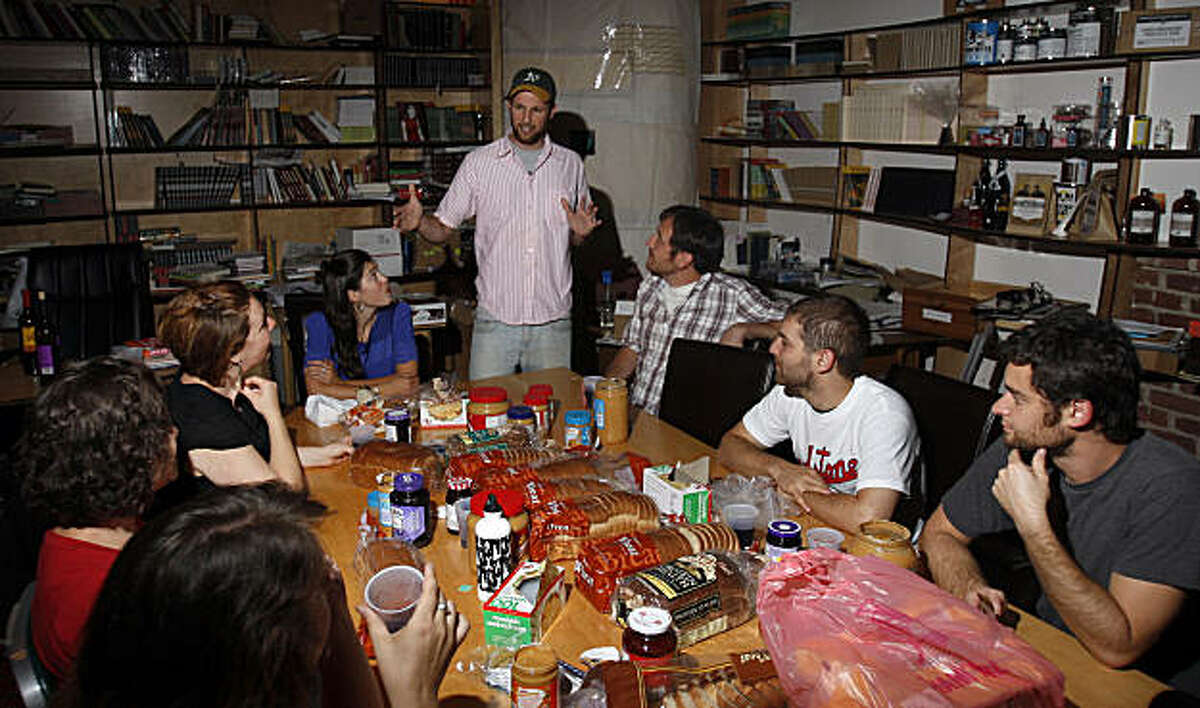 Ryan Lewis (standing) gives some last minute details to a group of volunteers on how to make the proper peanut butter jelly sandwich for the