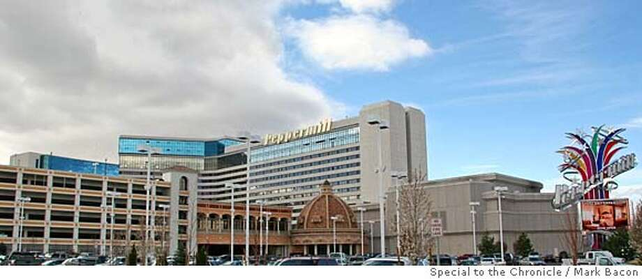 ###Live Caption:The Peppermill Hotel Casino as seen from South Virginia Street. The top of the new Tuscan Tower is visible to the left, just above the new parking garage.###Caption History:The Peppermill Hotel Casino as seen from South Virginia Street. The top of the new Tuscan Tower is visible to the left, just above the new parking garage.###Notes:###Special Instructions: Photo: Mark Bacon