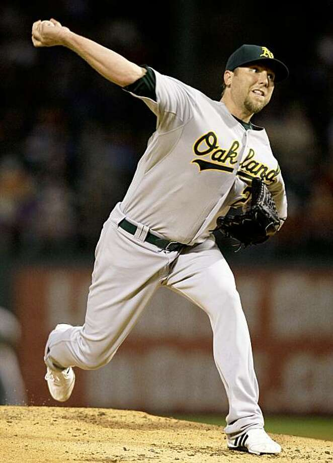 Oakland Athletics starting pitcher Brett Tomko delivers to the Texas Rangers in the second inning of a baseball game in Arlington, Texas, Monday, Sep 14, 2009. (AP Photo/Tony Gutierrez) Photo: Tony Gutierrez, AP