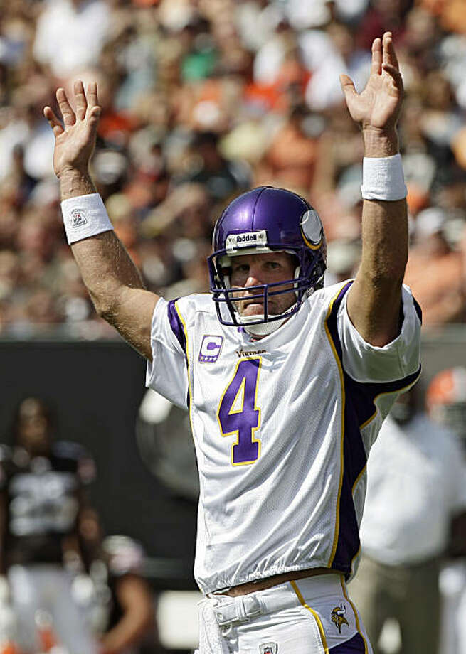 Minnesota Vikings quarterback Brett Favre celebrates after a 1-yard touchdown run by Adrian Peterson in the second quarter of an NFL football game against the Cleveland Browns Sunday, Sept. 13, 2009, in Cleveland. (AP Photo/Mark Duncan) Photo: Mark Duncan, AP