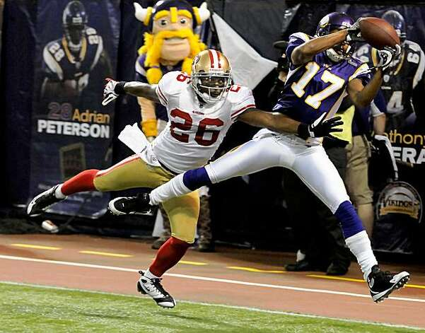 Vikings receiver Greg Lewis (17) catches the winning touchdown under pressure from the 49ers Mark Roman (26) to put the Vikings ahead 27-24 in an NFL football game at the Metrodome in Minneapolis, Minn., on Sunday, Sept. 27, 2009. (AP Photo/Pioneer Press, Ben Garvin) ** MINNEAPOLIS OUT; MANDATORY CREDIT; MAGAZINES OUT; NO SALES ** Photo: Ben Garvin, AP