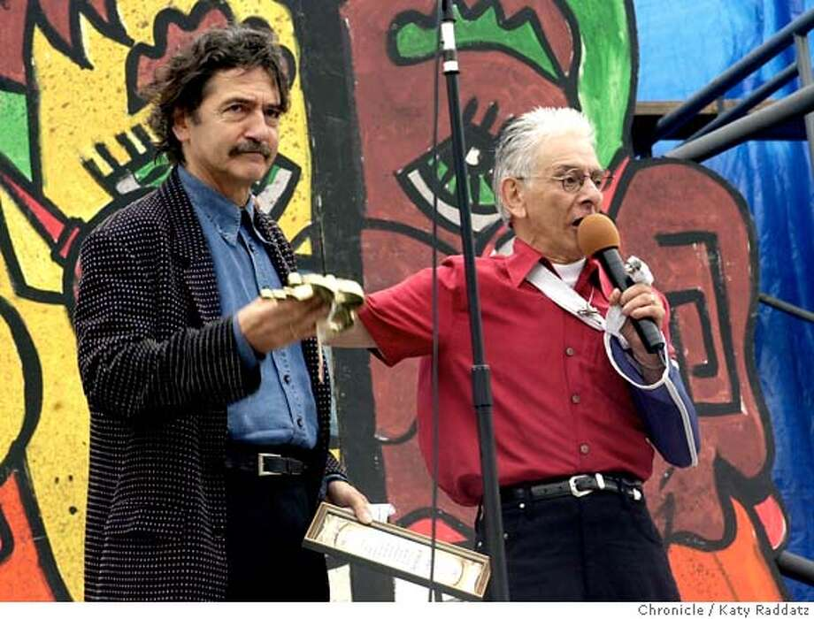 ###Live Caption:Don Novello, comic, creator of Guido Sarducci, receives an award at the 23rd Annual Comedy Day in Golden Gate Park, San Francisco. Presenting the award is Jose Simon###Caption History:NOVELLO045_radA.jpg Don Novello, comic, creator of Guido Sarducci, receives an award at the 23rd Annual Comedy Day in Golden Gate Park, San Francisco. Presenting the award is Jose Simon. KATY RADDATZ / The Chronicle###Notes:###Special Instructions:MANDATORY CREDIT FOR PHOTOG AND SF CHRONICLE/NO SALES-MAGS OUT Photo: KATY RADDATZ